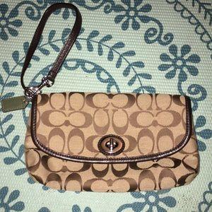 Coach brown and tan wristlet purse